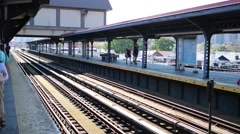 Arrival train and waiting passenger in Brighton Beach area Stock Footage