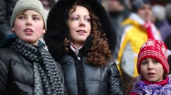 Mother with daughter and son on stadium during sport game Stock Footage