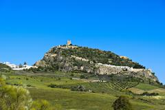 Hill with the keep of a Moorish castle Zahara de la Sierra Andalucia Spain - stock photo