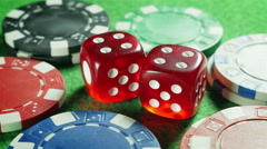 Red dices and casino chips on the green cloth background. Rotation. Double four. - stock footage