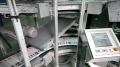Moving of magazines on conveyor in typographic workshop Stock Footage