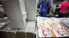 Workers and printed sheets in shop floor in Typographic complex Stock Footage