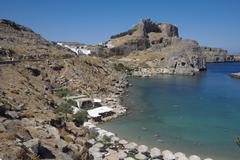 Apostle Pauls Bay behind Acropolis Lindos Rhodes Dodecanese Greece Europe - stock photo