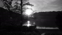People walking by the lake at day ending Stock Footage