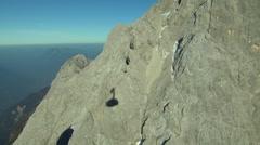 Gondola shadow while ascending mountain in Tirol Stock Footage