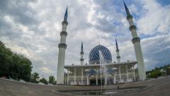 Daylight Clouds Time Lapse at a Mosque. Pan right to left. Fish eye lens. - stock footage