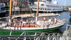 People on deck of sailing ship in harbor in Boston, United States. Stock Footage