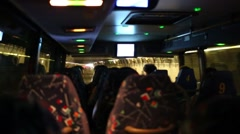 Heads of people and seat in bus moving in tunnel during trip in USA Stock Footage