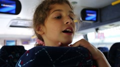 Face of beautiful girl traveling in bus with blue seats Stock Footage