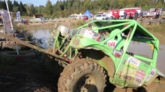 Tractor drags car in off-road competition RainForest Stock Footage