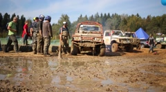 People near dirty car in off-road competition Stock Footage