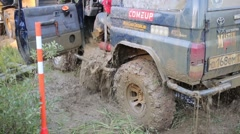 Drainage of car in off-road competition RainForest Challenge Russia Stock Footage