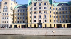 Beautiful buildings near embankment and bridge in Moscow, Russia Stock Footage