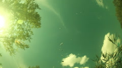 Clouds are moving the view from under the water. Timelapse - stock footage
