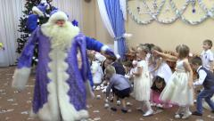 Children playing toy snowball fight on New Year's kindergarden performance Stock Footage