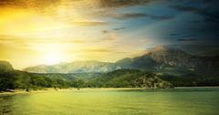 Fantastic sunrise on the beach Stock Photos