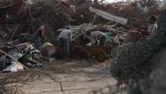 Men Working on a Scrap Yard. Wiring in the foreground. Stock Footage