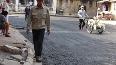 Workers are pouring asphalt - stock footage