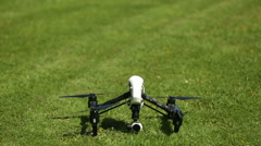 Quadcopter / Drone taking off, landing gear retracting and hovering Stock Footage
