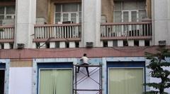 man sitting on scaffolding - stock footage