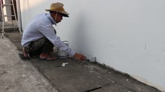 Vietnamese men painting the wall.  Stock Footage