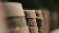 Slider shot of old rustic whisky barrels outside - stock footage