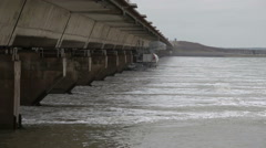 The Oosterschelde barrier / Eastern Scheldt storm surge barrier in Zeeland Stock Footage