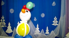 Snowman of balls on a blue background Stock Footage