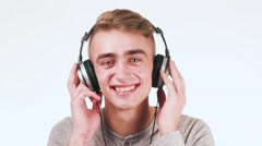 Handsome guy listening to music on headphones and dancing. DJ is very nice. Stock Footage