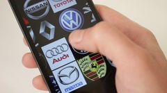 Car Brands Logos On Smartphone Stock Footage