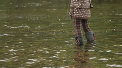 A female fly fishing on the river Nevis in the Scottish highlands Stock Footage