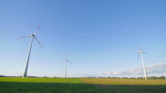 Wind power plants and blue sky pan Stock Footage