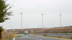 Wind power plant on the highway Stock Footage