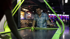 Adult man playing air hockey Stock Footage