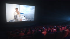 Group of people are watching a drama film screening in a movie cinema theater - stock footage
