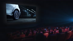 Group of people are watching an action film screening in a movie cinema theater - stock footage