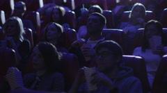 Group of people are laughing while watching a comedy film screening in a cinema Stock Footage
