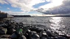 Waves Crashing on Rocks and Pier Seattle Sound Washington Stock Footage