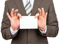 Businessman holding small empty paper - stock photo