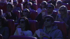 Group of people in 3d glasses are scared while watching a horror film screening Stock Footage