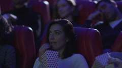 Man is sleeping while people are watching a film screening in a cinema - stock footage
