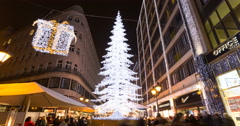 Christmas Tree in Central Christmas Market In Budapest,  Time Lapse - Tilt Down Stock Footage