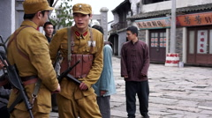 Actors acting a war film in Hengdian - stock footage