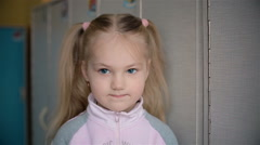 Portrait of a 5 year-old child serious look Stock Footage