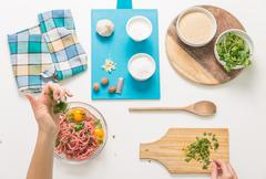 Good-looking female hands while preparing delicious traditional italian meatb - stock photo