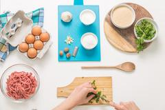 Good-looking female hands while preparing delicious traditional italian meatb Stock Photos