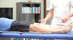 Doctor or physiotherapist performing knee mobility examination - stock footage