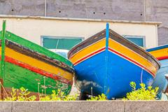 Colorful old fishing boats - stock photo