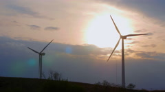 Wind power plants on the sunset Stock Footage