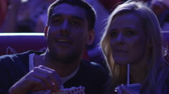 Group of happy people are watching a film screening in a movie cinema theater - stock footage